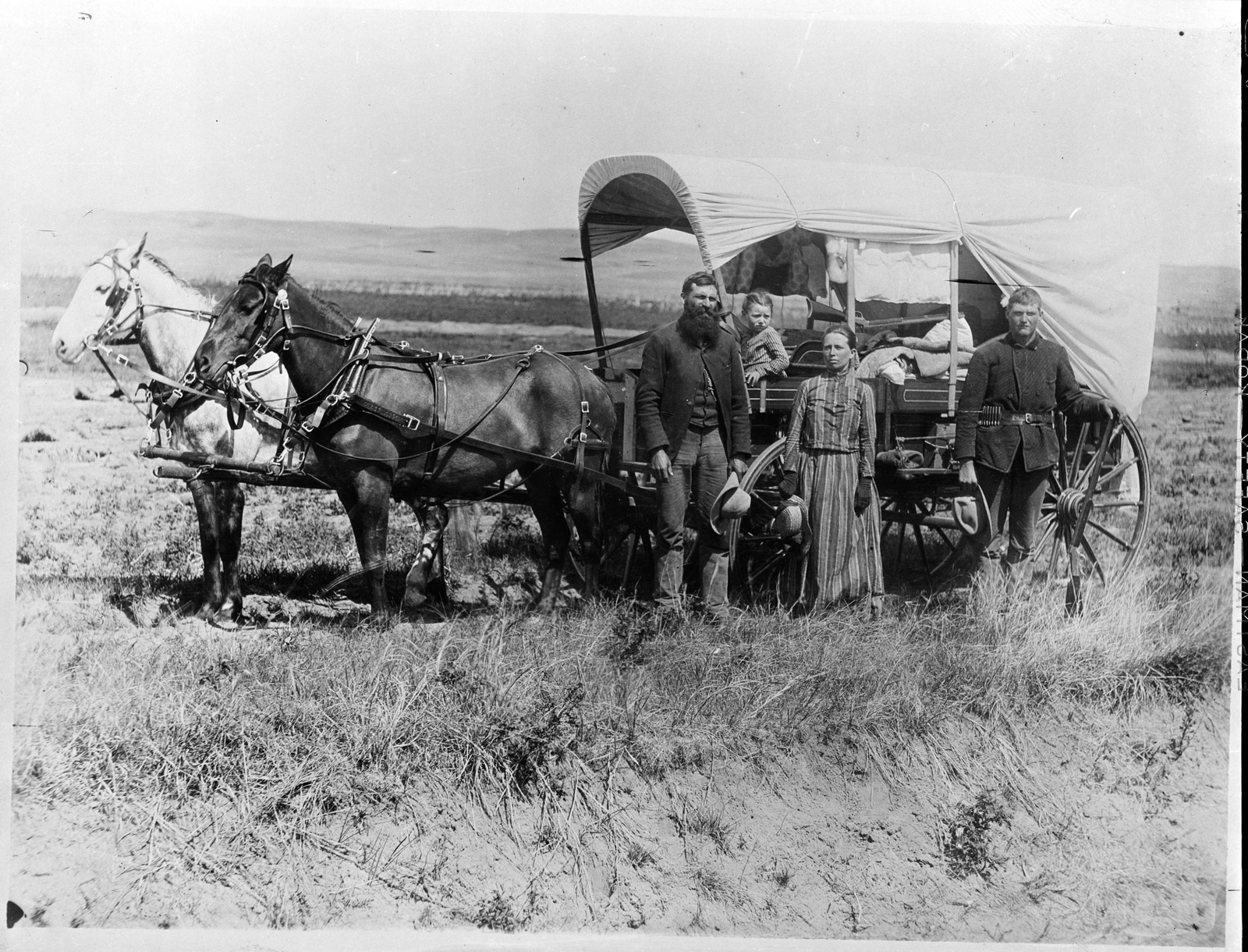 Photograph of a Family with Their Covered Wagon During the Great Western Migration