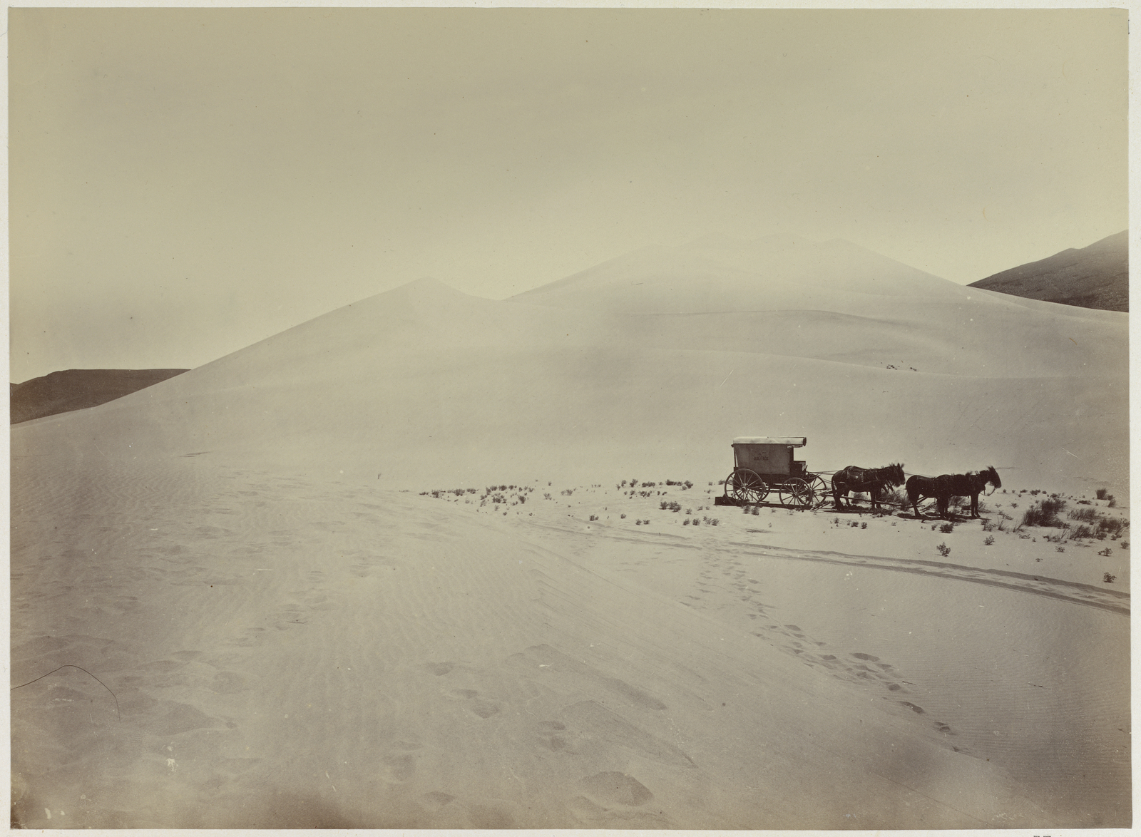 Photograph of Timothy O'Sullivan's Ambulance Wagon and Portable Darkroom on the Sand Dunes of Carson Desert during the King Survey
