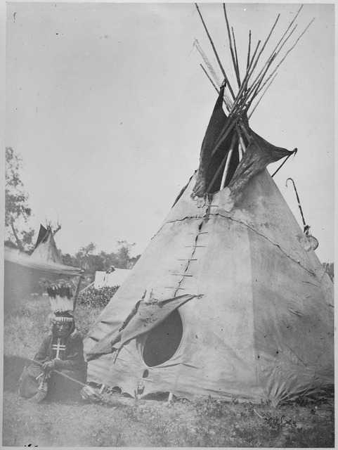 Little Big Mouth, a Medicine Man, Seated in front of his Lodge near Fort Sill, Oklahoma, with Medicine Bag Visible from behind the Tent