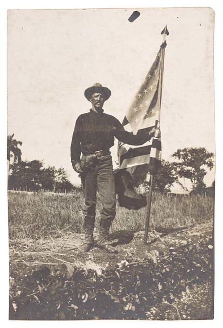 Photograph of a Soldier Holding an American Flag