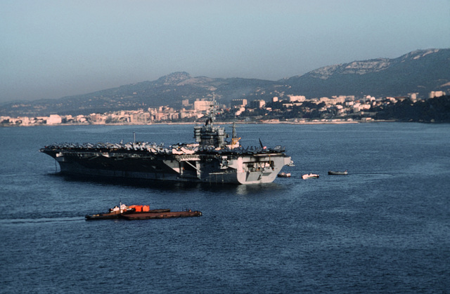 LT. P. J. Azzolina Gulfe du Lion....A port quarter view of the nuclear-powered aircraft carrier USS Dwight D. Eisenhower (CVN-69) anchored off the coast of Toulon, France. OFFICIAL U.S. NAVY PHOTO (RELEASED)