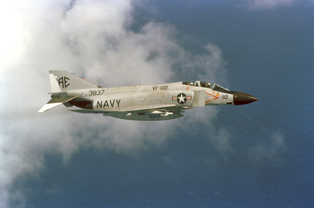 PH2 W. M. Welch Caribbean Sea....An air-to-air right side view of a Fighter Squadron 102 (VF-102) F-4 Phantom II aircraft. OFFICIAL U.S. NAVY PHOTO (RELEASED)