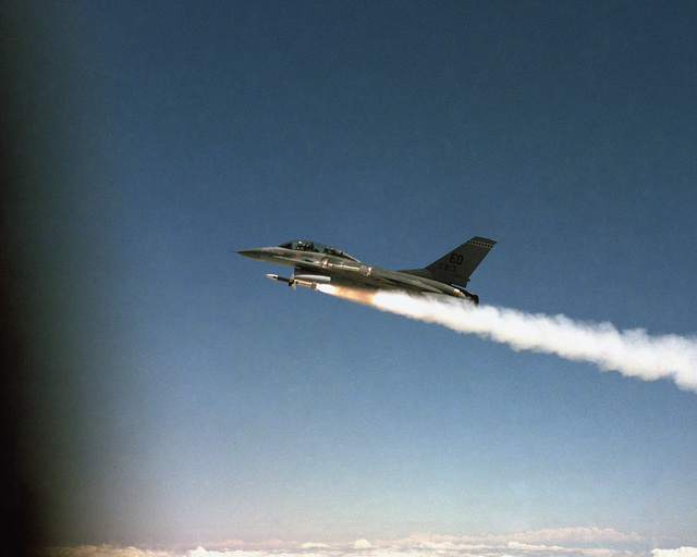 Reynolds California....An air-to-air left side view of an F-16B Fighting Falcon aircraft firing an AGM-45 Shrike missile over the Edwards Air Force Base Test Range. Second view in a series of three OFFICIAL U.S. AIR FORCE PHOTO (RELEASED)