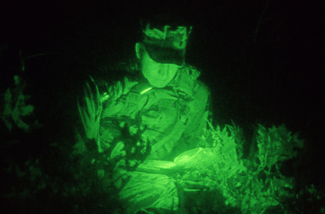 STAFF SGT. Charles Taylor Hurlburt Field, Fla....An airman uses a flashlight to read a map during the night navigation event, part of the annual Tactical Air Command Control SPECIALIST competition. OFFICIAL U.S. AIR FORCE PHOTO (RELEASED)