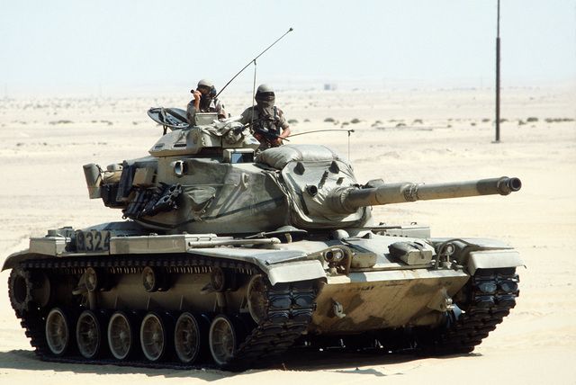 American soldiers demonstrate the capabilities of an M-60A1 main battle tank to Egyptian observers during the joint Exercise Bright Star '83