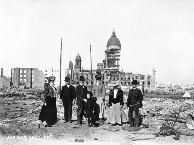A small group of San Franciscans now stands in rubble where 308 Van Ness Avenue once stood. In the background is whats left of City Hall. On April 18, 1906 at 5:15 AM a quake of 8.25 on the Richter scale hit San Francisco. Greater destruction came from the fires afterwards. The city burned for three days. The combination destroyed 490 city blocks and 25,000 buildings, leaving 250,000 homeless and killing between 450 and 700. Estimated damages, over $350 million