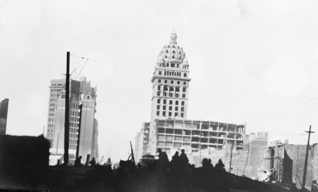 A view along Market Street at the remains of the Call Building (domed) (right), the Mutual Bank Building (left), and the Chronicle Building (rear). On April 18, 1906 at 5:15 AM a quake of 8.25 on the Richter scale hit San Francisco. Greater destruction came from the fires afterwards. The city burned for three days. The combination destroyed 490 city blocks and 25,000 buildings, leaving 250,000 homeless and killing between 450 and 700. Estimated damages, over $350 million