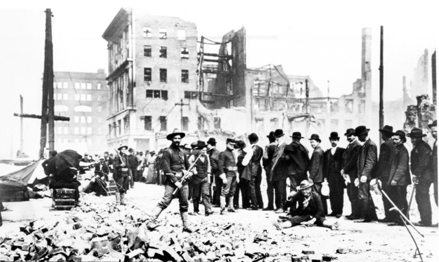 As soldiers from the Presidio patrol with their Springfield 03 at ready, civilians queue up in bread lines for food in the aftermath of the quake. On April 18, 1906 at 5:15 AM a quake of 8.25 on the Richter scale hit San Francisco. Greater destruction came from the fires afterwards. The city burned for three days. The combination destroyed 490 city blocks and 25,000 buildings, leaving 250,000 homeless and killing between 450 and 700. Estimated damages, over $350 million