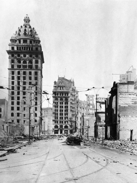Burnt-out truck of an inbound streetcar lies on Third Street between Market and Mission. The Call Building (left) at the corner of Third and Market streets. Mutual Savings Bank is across Market and Kearny. On April 18, 1906 at 5:15 AM a quake of 8.25 on the Richter scale hit San Francisco. Greater destruction came from the fires afterwards. The city burned for three days. The combination destroyed 490 city blocks and 25,000 buildings, leaving 250,000 homeless and killing between 450 and 700. Estimated damages, over $350 million