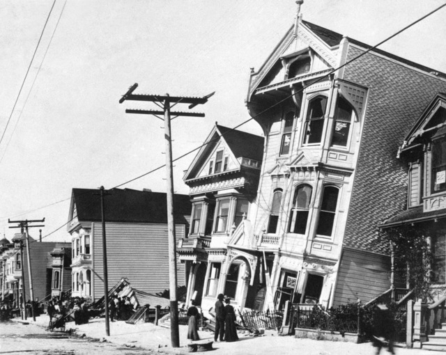 "GROUND EFFECTS AND BUILDING DAMAGE On the east side of Howard Street near 17th Street in San Francisco all houses shifted toward the left. The three-story house dropped from its south foundation wall and leaned against the neighboring house. This area, called the Mission District, was a ""fill"" area along the former course of Mission Creek. It was an area of high-intensity shaking exceeded only by areas in close proximity to the fault. For blocks the land surface and paved streets were thrown into wave forms trending east and west. U.S. Geological Survey (Possible photograph by G.K. Gilbert)"