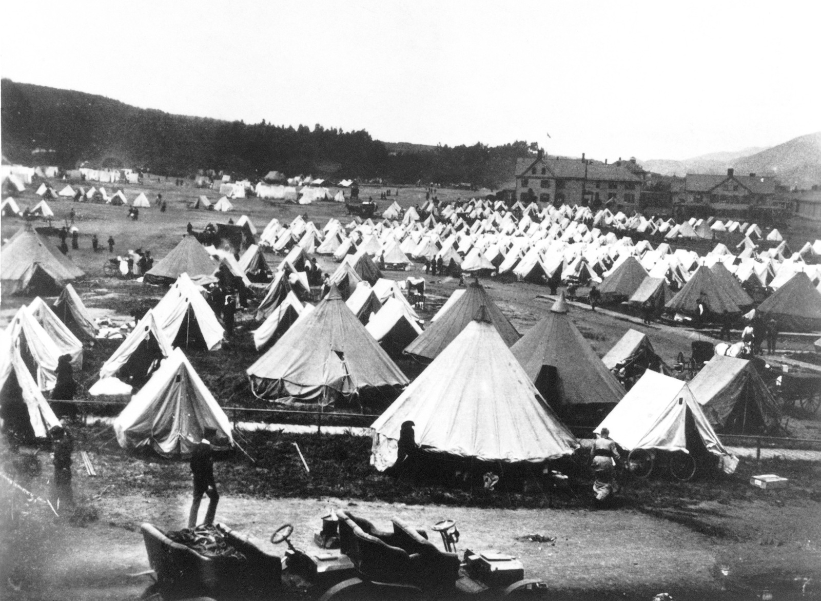 Like nomads settling in for a stay this is the largest tent refugee camp on the Presidio Reservation. United States Army General Hospital is in the background. On April 18, 1906 at 5:15 AM a quake of 8.25 on the Richter scale hit San Francisco. Greater destruction came from the fires afterwards. The city burned for three days. The combination destroyed 490 city blocks and 25,000 buildings, leaving 250,000 homeless and killing between 450 and 700. Estimated damages, over $350 million