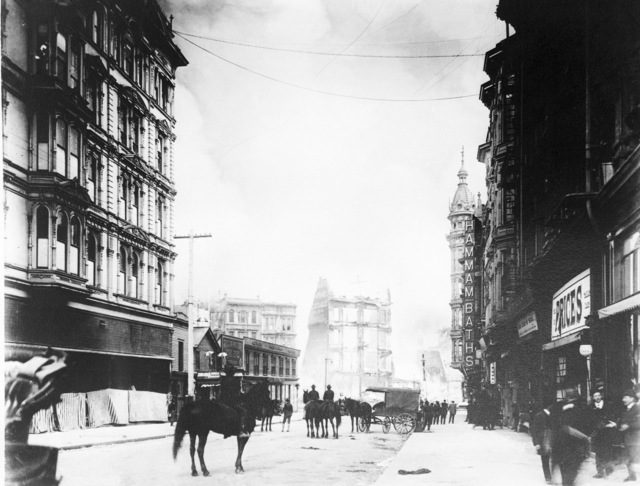 Men ride horseback on an unidentified street showing some of the earthquake damage in the background. On April 18, 1906 at 5:15 AM a quake of 8.25 on the Richter scale hit San Francisco. Greater destruction came from the fires afterwards. The city burned for three days. The combination destroyed 490 city blocks and 25,000 buildings, leaving 250,000 homeless and killing between 450 and 700. Estimated damages, over $350 million