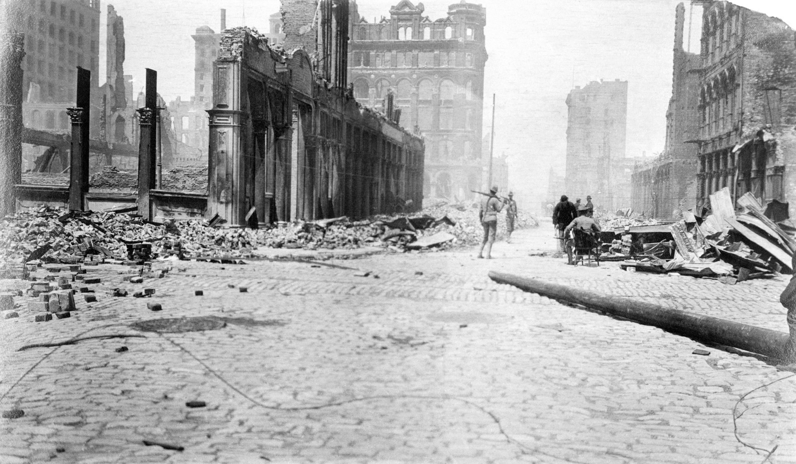 Soldiers from the Presidio patrol this area, looking north from the junction of Sansome and Bush Streets. The area is known as the insurance district of San Francisco. On April 18, 1906 at 5:15 AM a quake of 8.25 on the Richter scale hit San Francisco. Greater destruction came from the fires afterwards. The city burned for three days. The combination destroyed 490 city blocks and 25,000 buildings, leaving 250,000 homeless and killing between 450 and 700. Estimated damages, over $350 million