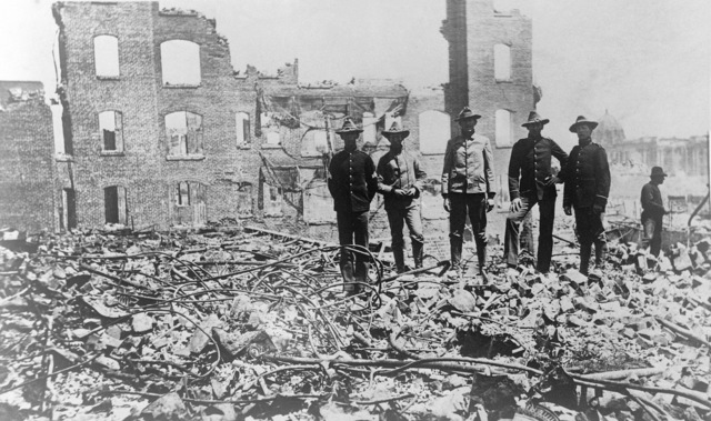 Soldiers from the Presidio stand amid the rubble of fallen buildings after the earthquake. The Hall of Records (dome) is in the background (right). On April 18, 1906 at 5:15 AM a quake of 8.25 on the Richter scale hit San Francisco. Greater destruction came from the fires afterwards. The city burned for three days. The combination destroyed 490 city blocks and 25,000 buildings, leaving 250,000 homeless and killing between 450 and 700. Estimated damages, over $350 million