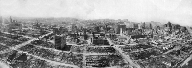 "Panoramic View of Nearly Total Devastation of San Francisco Other Effects of the Disaster  ""This view of the San Francisco ruins shows many square blocks completely leveled. The photograph was taken on May 1, 1906, almost a month after the disaster. Much of the debris had already been hauled away leaving only empty ash-blackened blocks. Rebuilding of small buildings had begun"