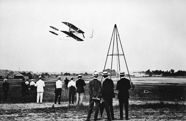 The Wright Brothers test fly their aircraft on Fort Myer's parade field. This series of test flights resulted in the Army purchasing its first aircraft. In the first flight, Sept. 9, 1908, Orville Wright kept the plane aloft 71 seconds. The second flight resulted in a crash that left Wright severely cut and bruised and his passenger, Army LT. Thomas Selfridge dead -- the first powered-aviation fatality. (Exact date shot UNKNOWN)