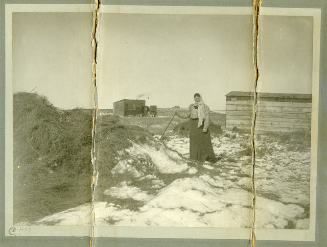 Photograph of A Woman with a Hay Stack