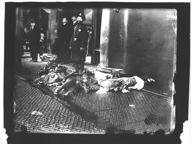Photograph of Police Officers, Civilians and Victims on the Sidewalk during the Triangle Shirtwaist Factory Fire