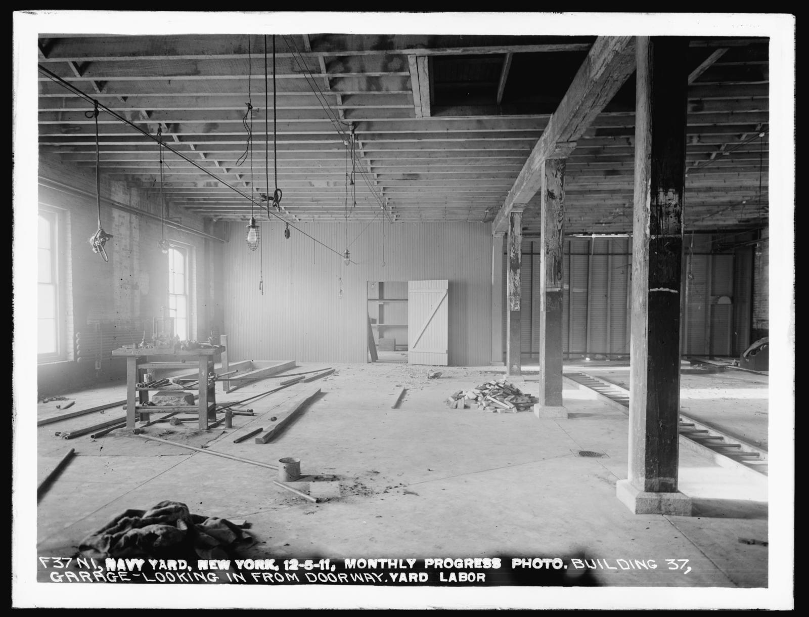 Monthly Progress Photo, Building 37, Garage - Looking in from Doorway, Yard Labor