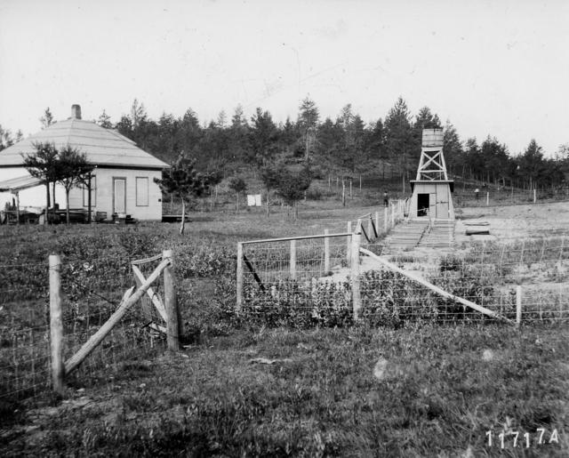 Photograph of a Tank, a Derrick, and a Pump House at Silver Creek Ranger Station