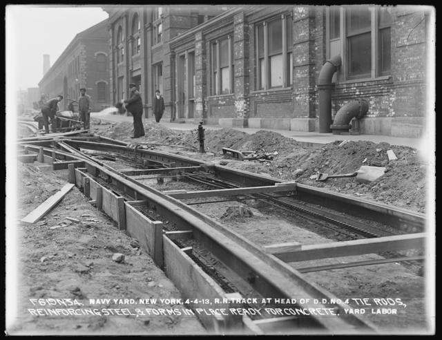 Railroad Track at Head of Dry Dock Number 4, Tie Rods, Reinforcing Steel, and Forms in Place, Ready for Concrete, Yard Labor