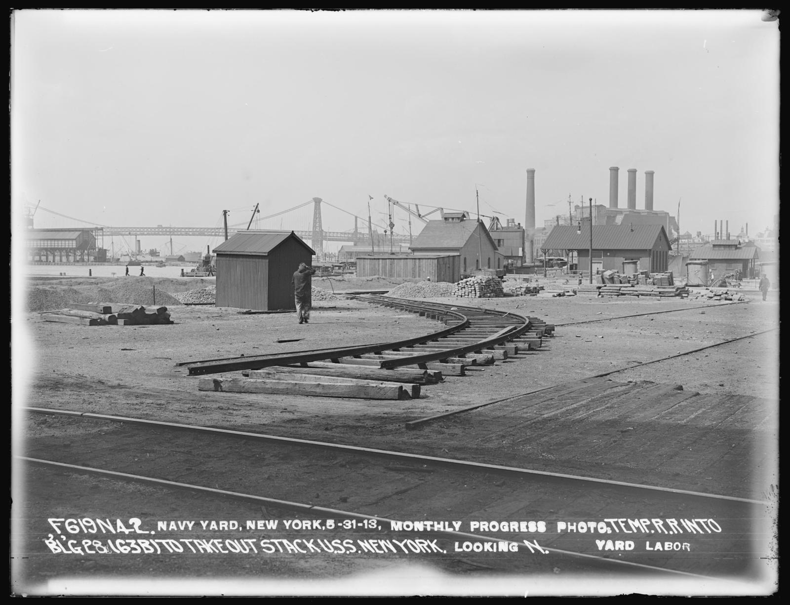 Monthly Progress Photo, Temporary Railroad into Building 28 (63-B) to Take Out Stack USS New York, Looking North, Yard Labor