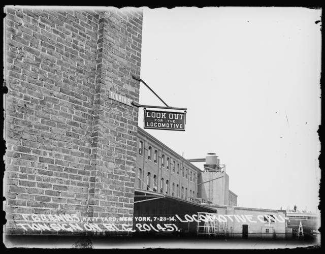 Locomotive Caution Sign on Building 20 (45)