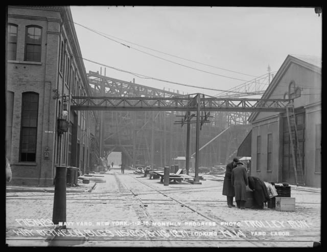 Monthly Progress Photo, Trolley Runway between Buildings 115 (26) and 116 (27), Looking Northwest, Yard Labor