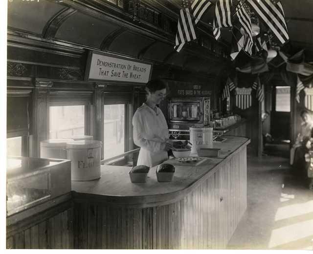 Photograph of Pennsylvania Food Conservation Train Female Volunteer Measuring Ingredients