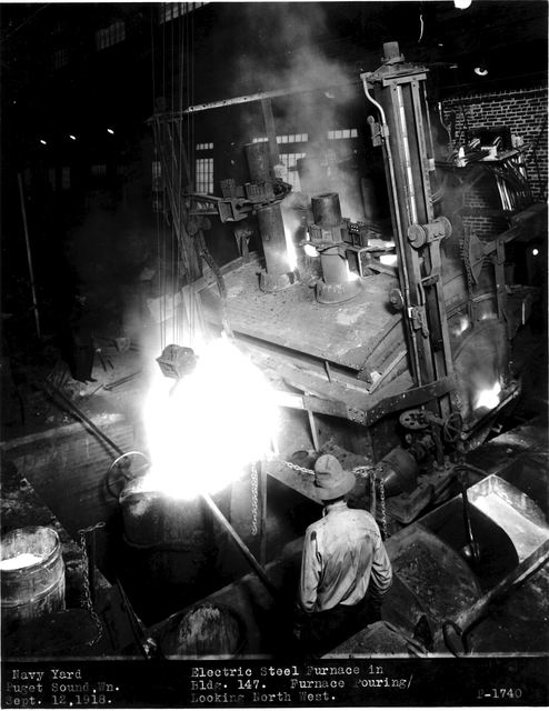 Photograph of a Shipyard Worker Operating a Furnace