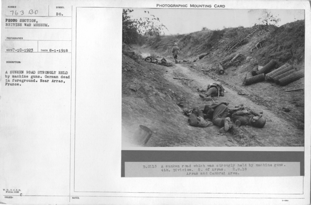 A sunken road strongly held by machine guns. German dead in foreground. Near Arras, France. 8-2-1918