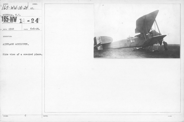 Airplanes - Accidents - Airplane Accidents. Side view of a wrecked plane. Mineola, N.Y