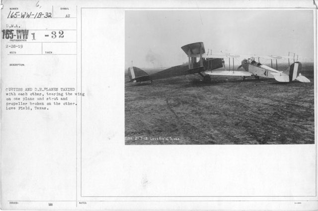 Airplanes - Accidents - Curtiss and D. H. planes taxied with each other, tearing the wing on one plane and strut and propeller broken on the other. Love Field, Texas. D.M.A