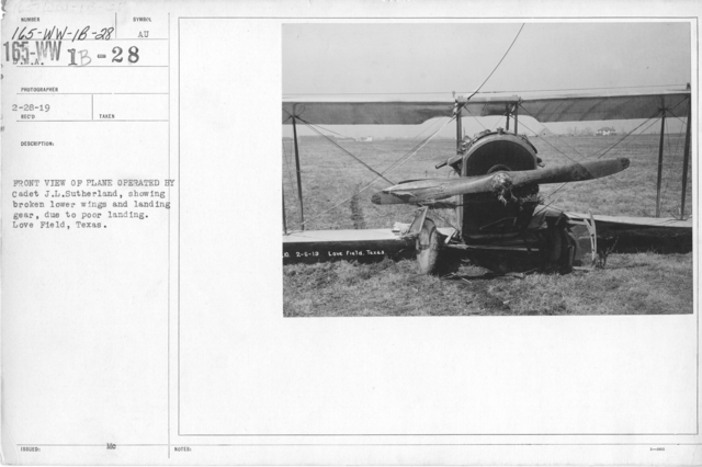 Airplanes - Accidents - Front view of plane operated by Cadet J. L. Sutherland, showing broken lower wings and landing gear, due to poor landing. Love Field, Texas. D.M.A