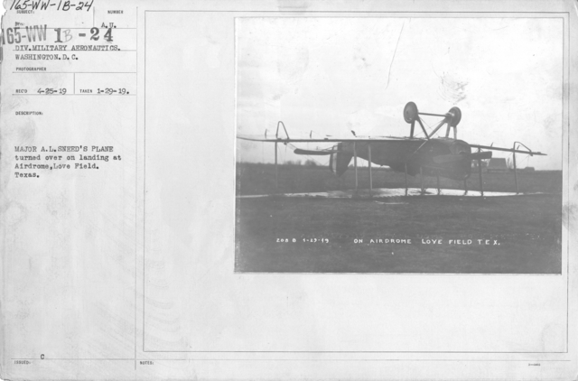 Airplanes - Accidents - Major A. L. Sneed's plane turned over on landing at Airdrome, Love Field, Texas.  Div. of Military Aeronautics. Washington, D.C