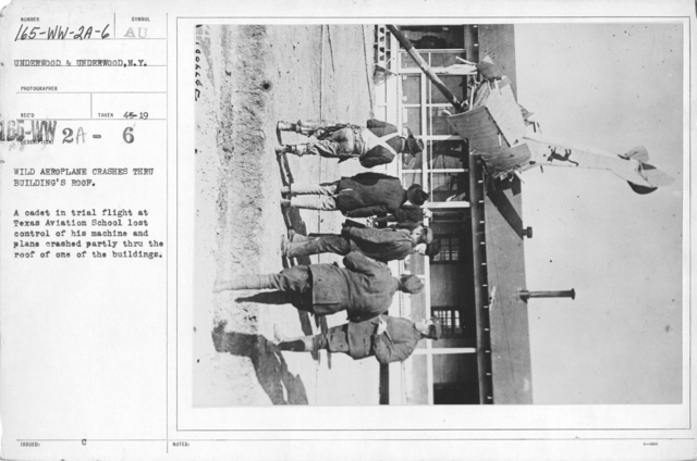 Airplanes - Accidents - Wild aeroplane crashes thru building's roof. A cadet in trial flight at Texas Aviation School lost control of his machine and plane crashed partly thru the roof of one of the buildings