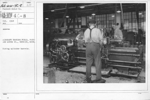 Airplanes - Engines - Aircraft testing field, Packard Motor Co., Detroit, Michigan. Boring cylinder barrels