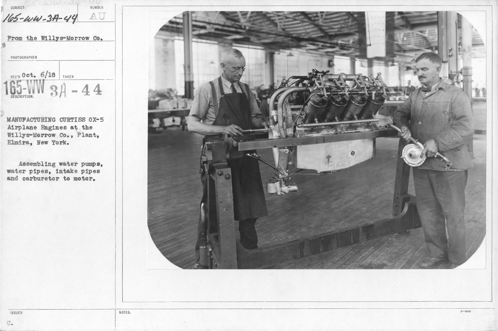 Airplanes - Engines - Manufacturing Curtiss Ox-5 airplane engines at the Willy-s Morrow Plant, Elmira, New York. Assembling water pumps, water pipes, intake pipes and carburetor to motor