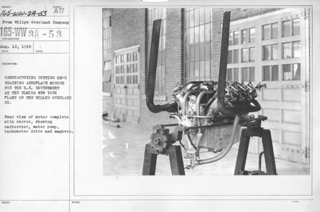 Airplanes - Engines - Manufacturing Curtiss Ox-5 airplane engines at the Willy-s Morrow Plant, Elmira, New York. Rear view of motor complete with stoves, showing carburetor, water pump, tachometer drive and magneto