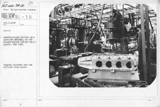 Airplanes - Engines - Manufacturing Curtiss Ox-5 airplane engines at the Willys-Morrow Plant, Elmira, New York. Tapping cylinder and cam shaft follower stud holes