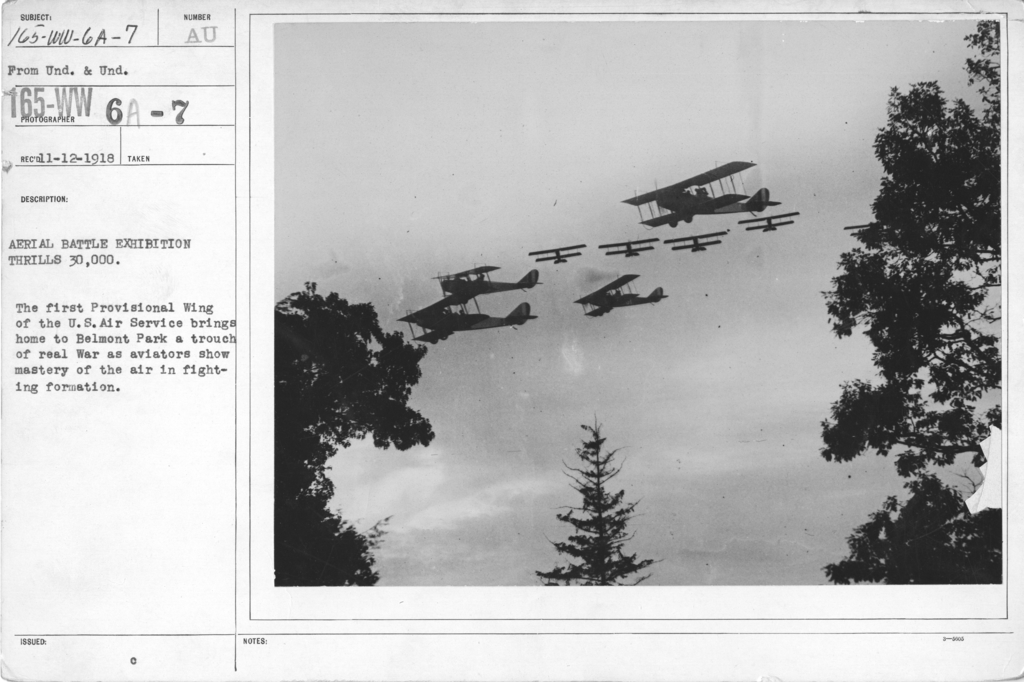 Airplanes - Flight - Aerial Battle Exhibition Thrills 30,000. The first Provisional Wing of the U.S. Air Service brings home to Belmont Park a touch of real War as aviators show mastery of the air in fighting formation