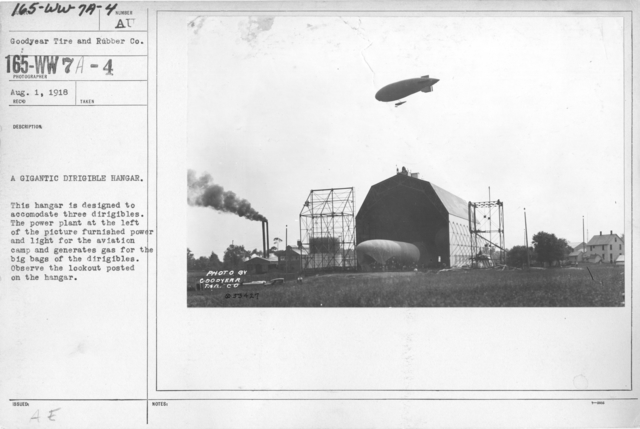 Airplanes - Hangars - A gigantic dirigible hangar. This hangar is designed to accommodate three dirigibles. The power plant at the left of the picture furnished power and light for the aviation camp and generates gas for the big bags of the dirigibles. Observe the lookout posted on the hangar