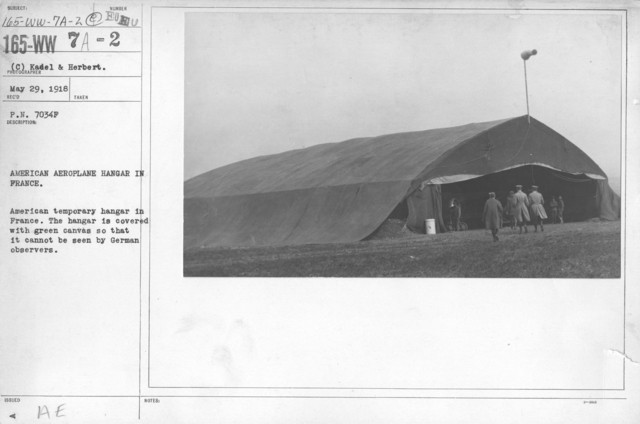 Airplanes - Hangars - American aeroplane hangar in France. American temporary hangar in France. The hangar is covered with green canvas so that it cannot be seen by German observers