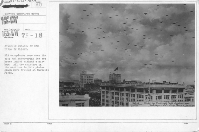 Airplanes - Historical - Aviators trained at San Diego in flight. 212 aeroplanes rose over the city and maneuvering for two hours landed without mishap. All the aviators in the machines in this photograph were trained at Rockwell Field