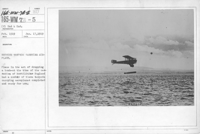Airplanes - Historical - British torpedo carrying airplane. Plane in the act of dropping a bomb- at the time of the cessation of hostilities England had a number of these torpedo carrying aeroplanes completed and ready for use