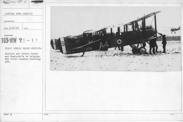 Airplanes - Historical - First aerial goods service. Woollen and Cotton Goods and Foodstuffs to Belgium. The first machine starting off. Central News Service