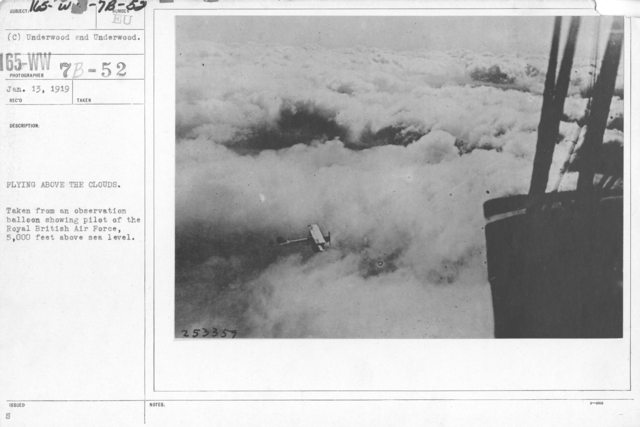 Airplanes - Historical - Flying above the clouds. Taken from an observation balloon showing pilot of the Royal British Air Force, 5,000 feet above sea level