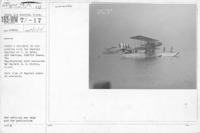 Airplanes - Historical - Using a sea-sled in connection with the Caproni Bi-plane at the U.S. Naval Air Station, Hampton Roads, VA. Experimental work conducted by Captain H.C. Mustin, U.S.N. Side view of Caproni plane on sea-sled