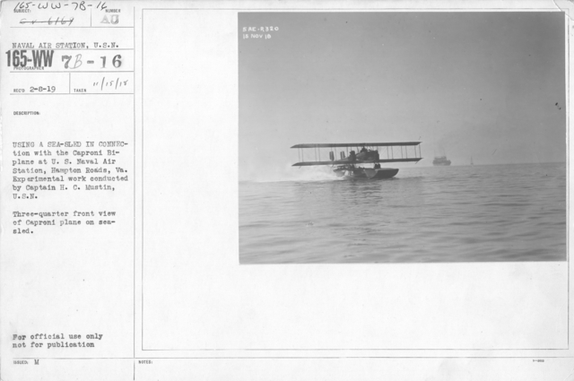 Airplanes - Historical - Using a sea-sled in connection with the Caproni Bi-plane at the U.S. Naval Air Station, Hampton Roads, VA. Experimental work conducted by Captain H.C. Mustin, U.S.N. Three-quarter front view of Caproni plane on sea-sled
