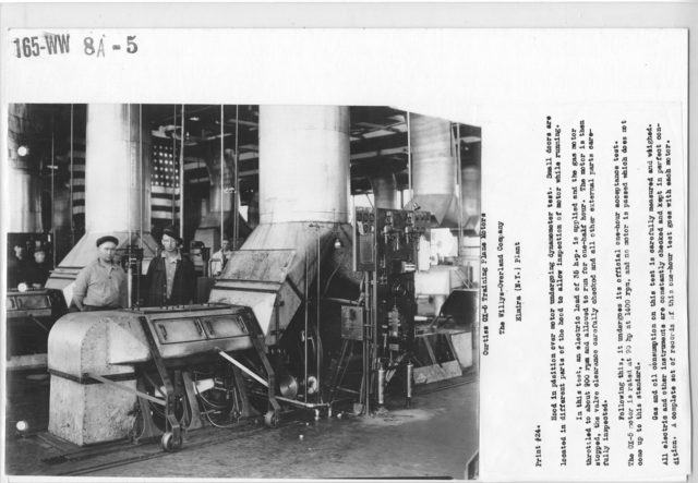 Airplanes - Inspection - Hood in position over motor undergoing dynamometer test. Small doors are located in different parts of the hood to allow inspection of motor while running. Curtiss OX-5 Training Plane Motors. The Willys- Overland Company, Elmira (N.Y.) Plant